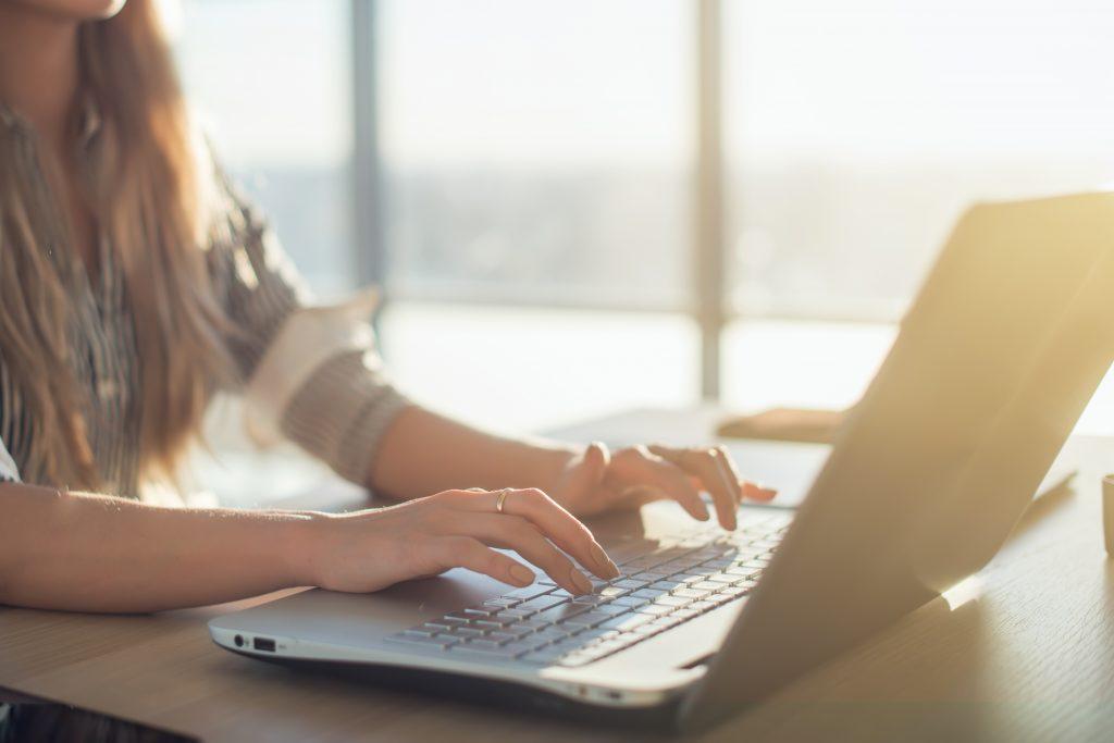 Woman attending webinar on achieving card program goals