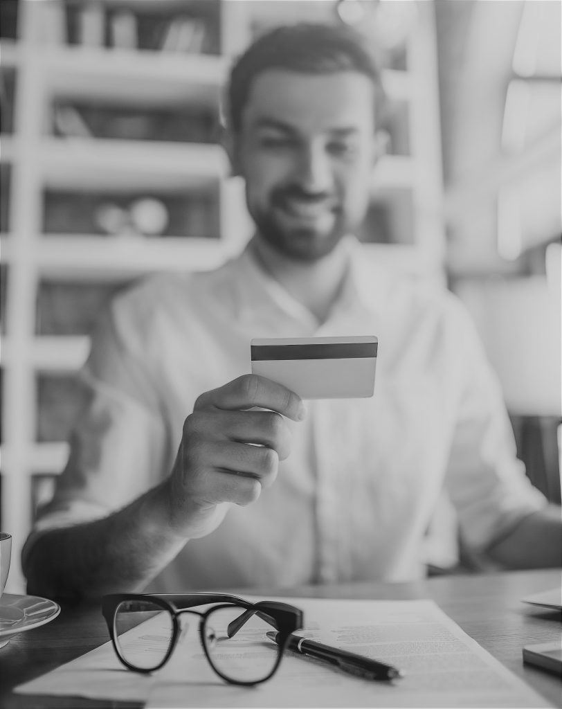 man working with credit card