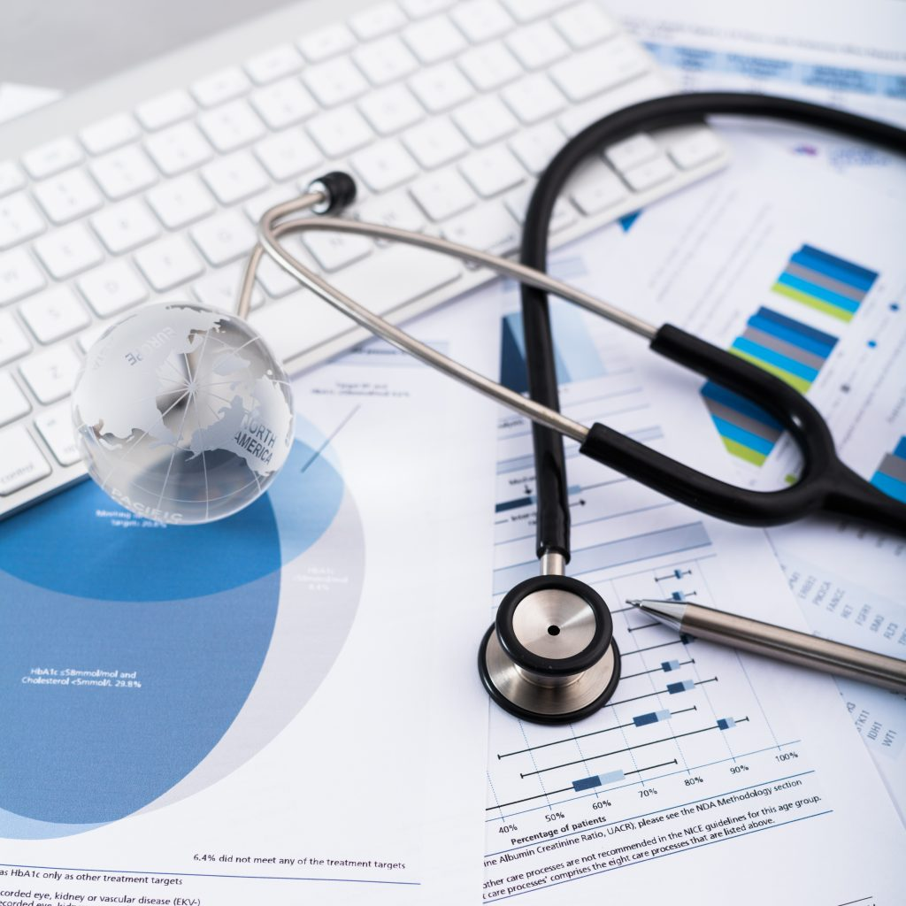 Stethoscope with financial on the desk
