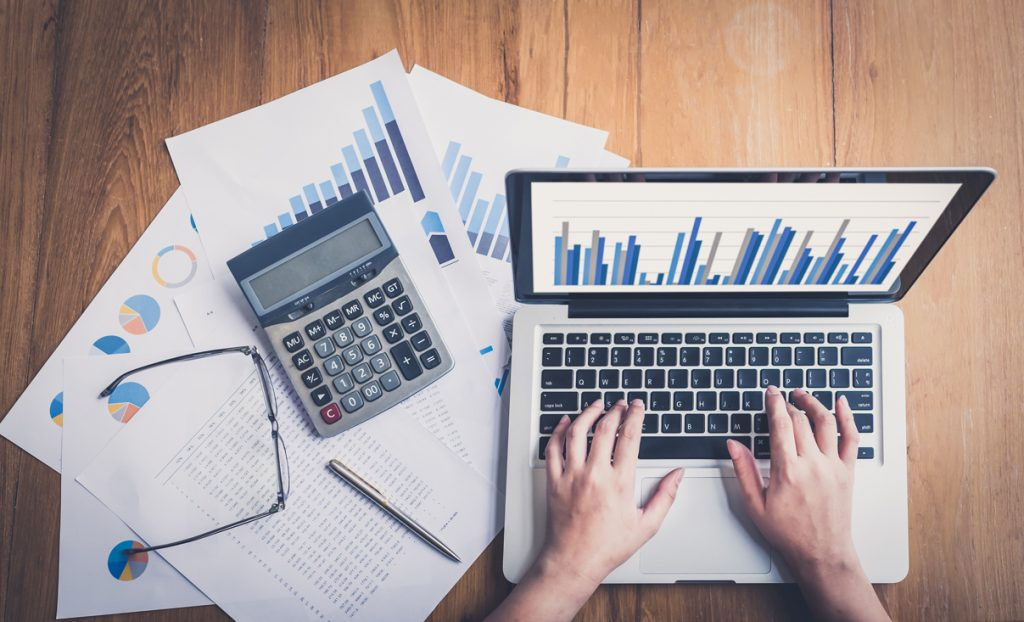 at the computer with finances