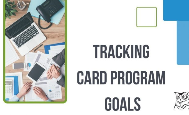Business managers tracking card program goals at computer